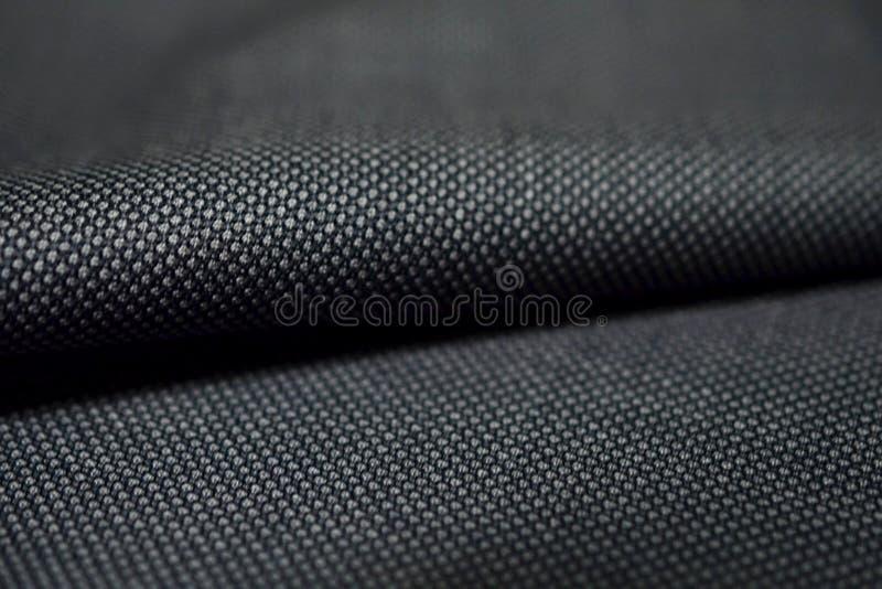 För rullmodell för slut övre tyg för grå färger för textur av dräkten fotografering för bildbyråer
