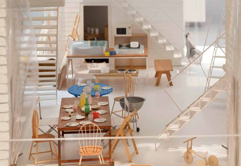 För sidosikt för lägenhet plan orientering, pappers- och papp Möblemang och moderna dekorer, modell av inre arkivbild