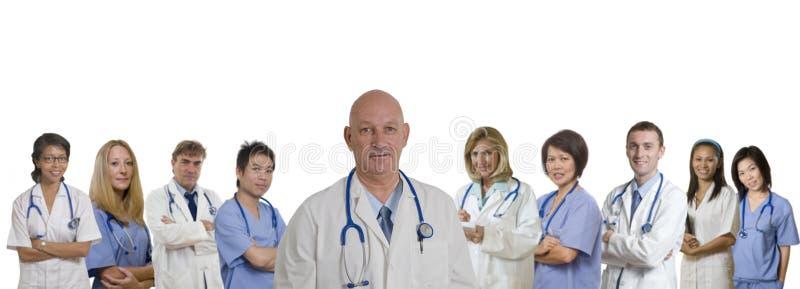 för sjukhusläkarundersökning för baner olik personal royaltyfria bilder