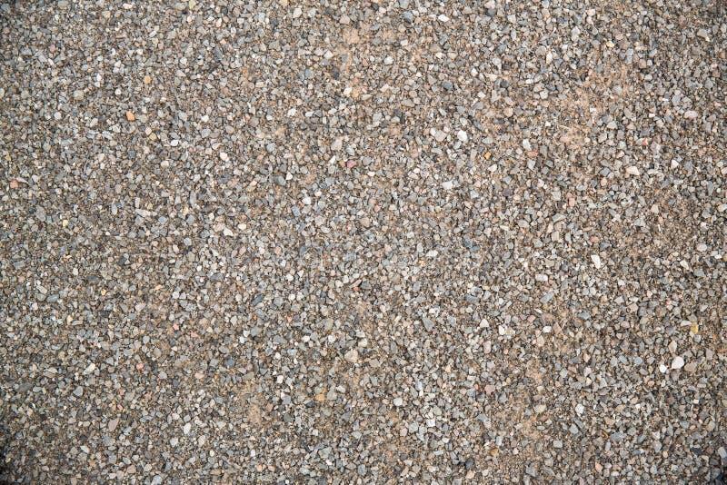 För slut fin grustextur upp grusbakgrund, kiselstentapet avbilda för bakgrund, tapetsera och kopiera utrymme arkivfoto