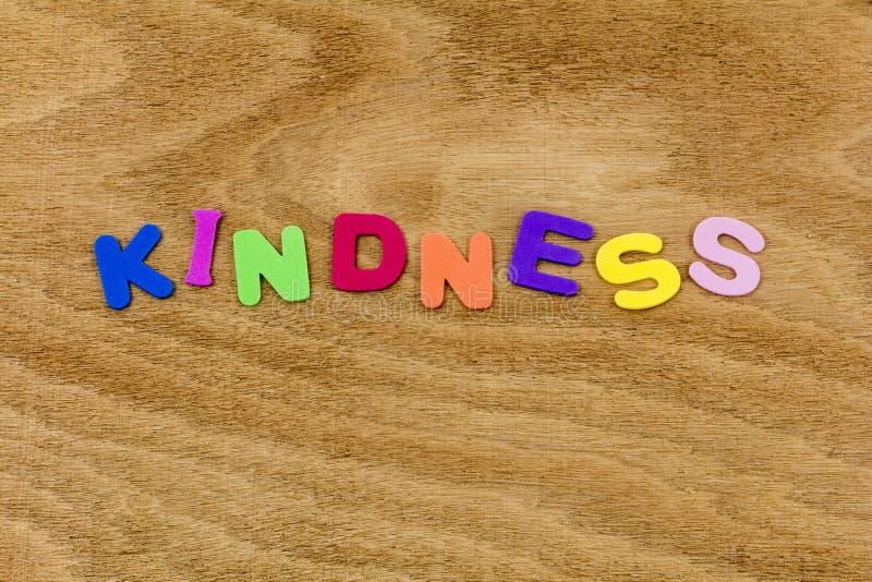 För snäll bokstäver för barn för pass hjälpvälgörenhet för vänlighet försiktiga arkivbild
