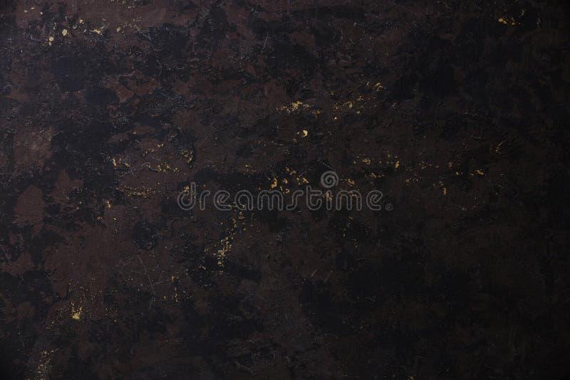 För stenbakgrund för mörk svart textur arkivfoto