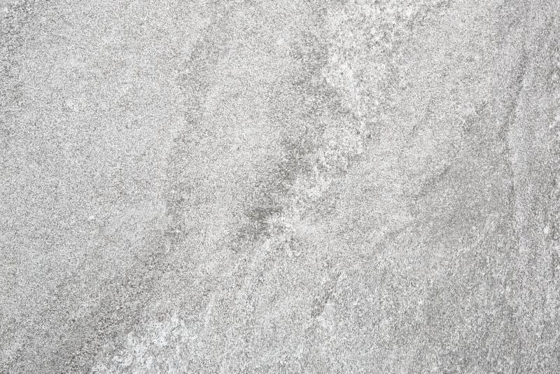 För stenvägg för grå betong slät bakgrund för textur arkivfoto