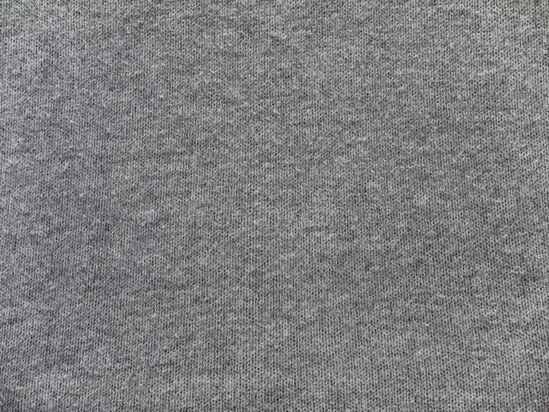 För stickade plaggtyg för ljung grå textur royaltyfri fotografi