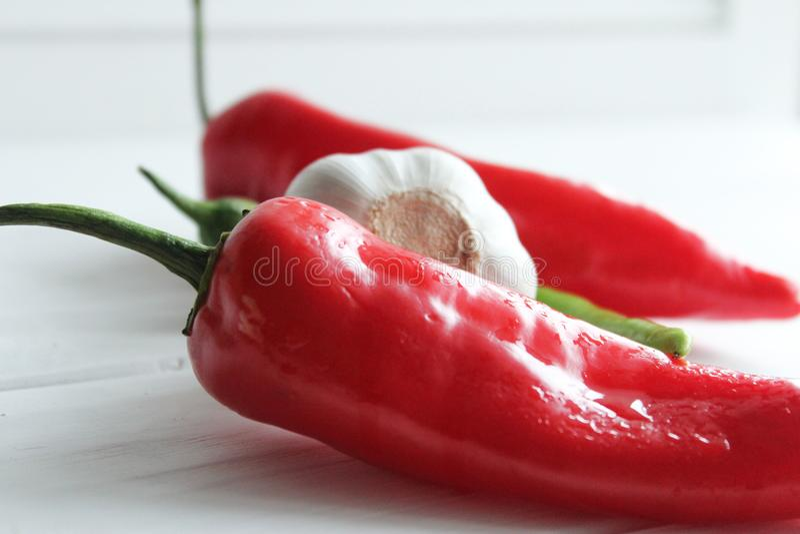För strikt vegetarianvitlök för peppar röd vit royaltyfri fotografi