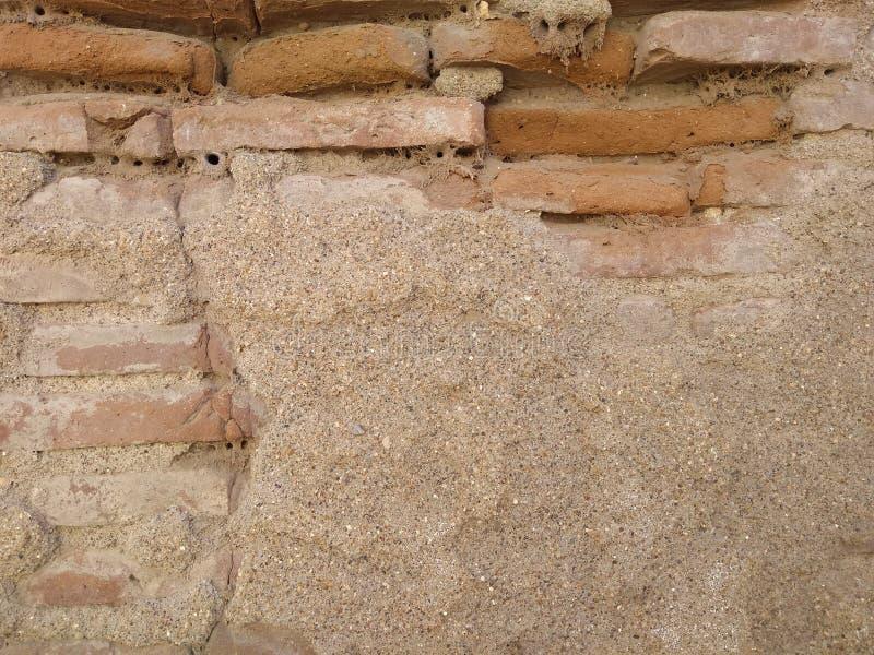 För tegelstenvägg för by förhistorisk textur royaltyfri foto