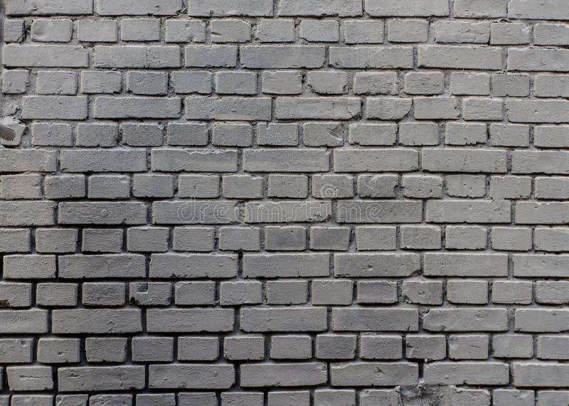 För tegelstenvägg för Grunge industriell grå målad bakgrund i Kyiv, Ukraina arkivbilder