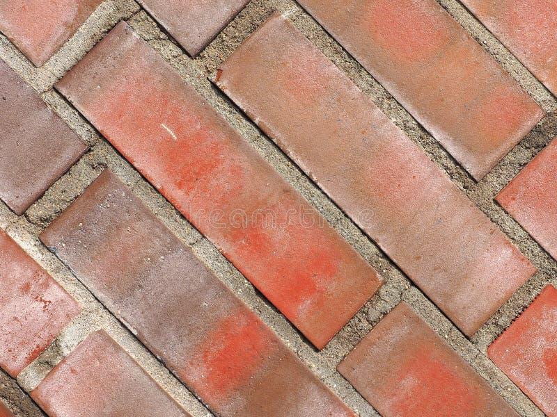 för texturbakgrund för röd tegelsten diagonala tegelplattor royaltyfri foto