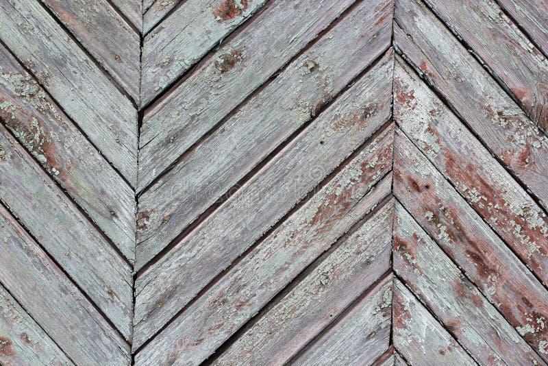 För texturbakgrund för tappning Wood sicksack, detaljfiskbensmönster av det gamla trästaketet fotografering för bildbyråer