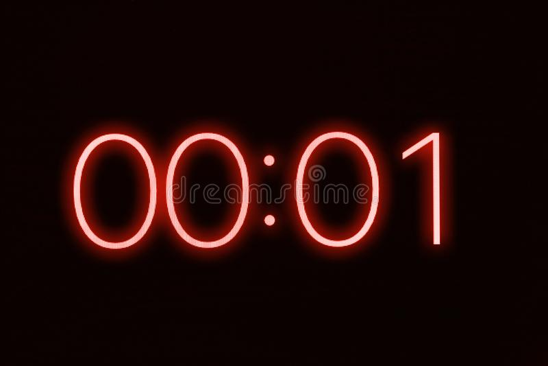 För tidmätarestoppur för Digital klocka som skärm visar 1 en sekund Nödläge spänning, ut ur tidbegrepp arkivbild