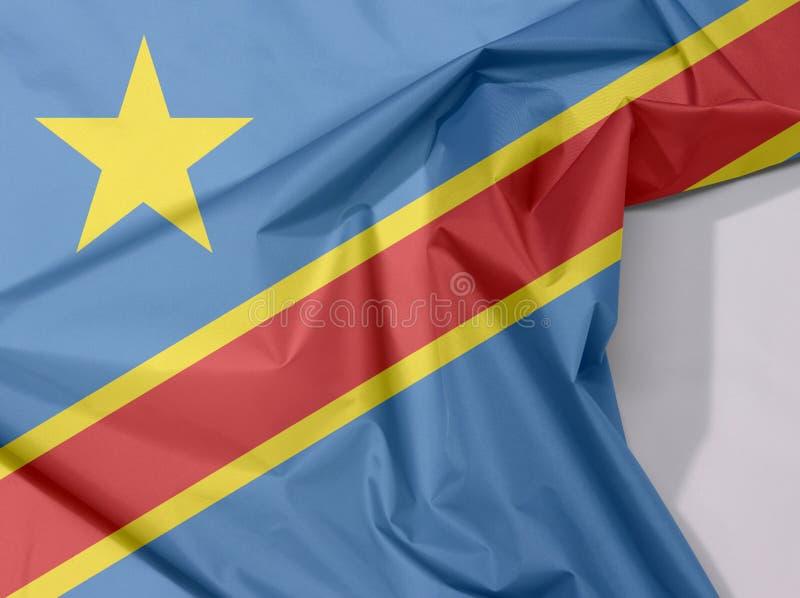För tygflagga för Dr Congo kräpp och veck med vitt utrymme royaltyfria bilder