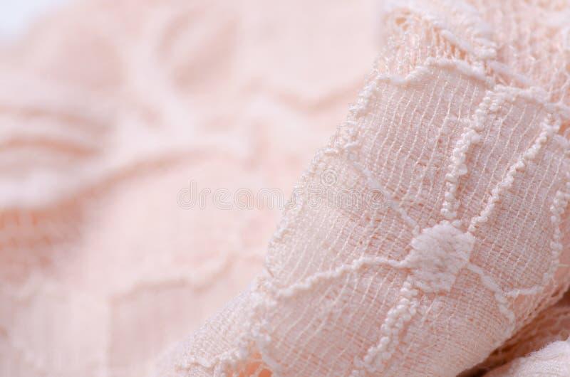 För tygtextil för persika makro för ingrepp för rosa textur för material openwork royaltyfri fotografi