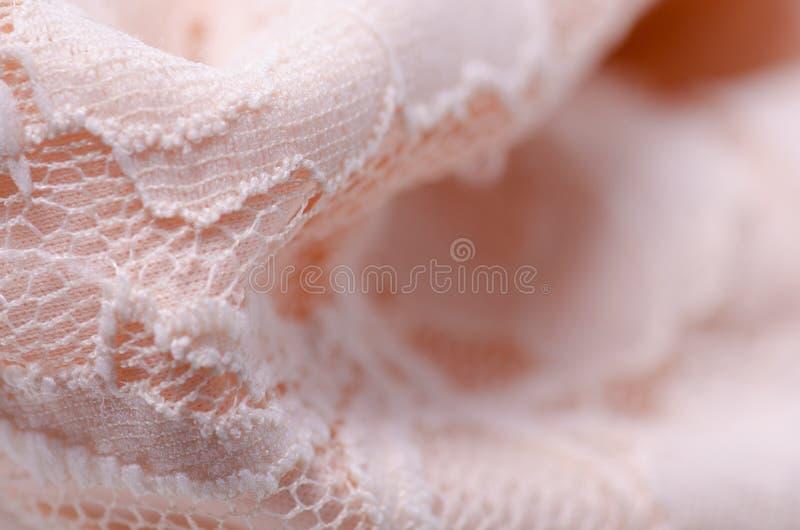 För tygtextil för persika makro för ingrepp för rosa textur för material openwork arkivfoto