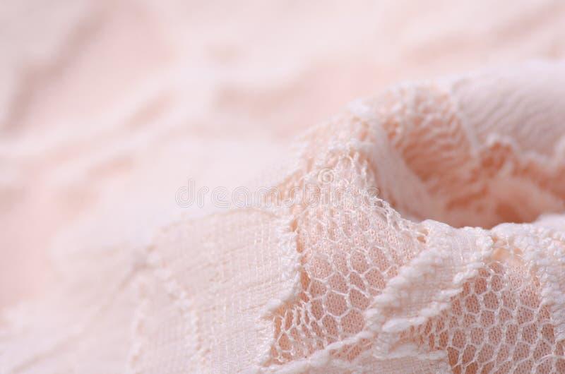 För tygtextil för persika makro för ingrepp för rosa textur för material openwork royaltyfria bilder