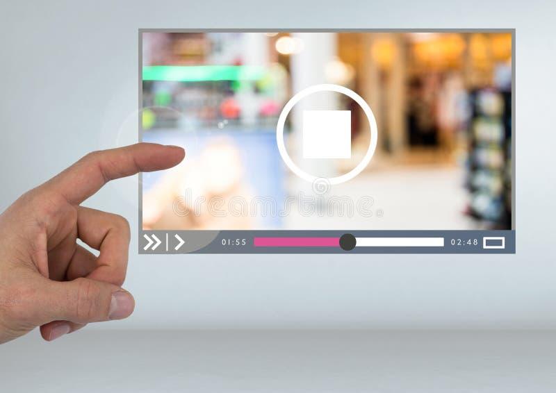 För videospelare för hand rörande manöverenhet för App royaltyfri foto
