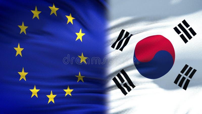 Förbindelse för bakgrund för EU- och Sydkorea flaggor diplomatiska och ekonomiska, finans arkivbild