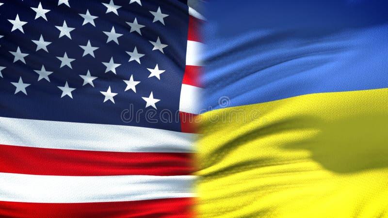 Förbindelse för bakgrund för Förenta staterna- och Ukraina flaggor diplomatiska och ekonomiska, arkivfoto