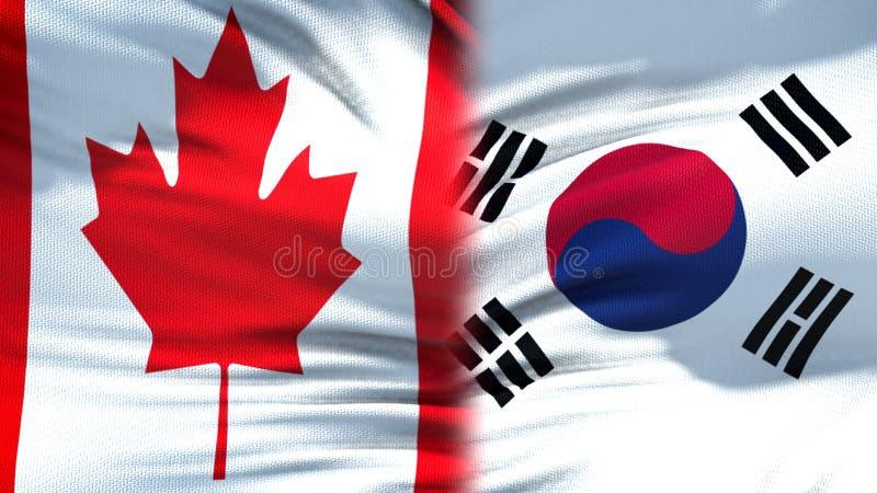 Förbindelse för bakgrund för Kanada och Sydkorea flaggor diplomatiska och ekonomiska, arkivfoto