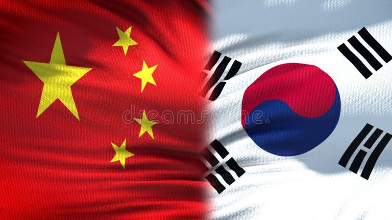 Förbindelse för bakgrund för Kina och Sydkorea flaggor diplomatiska och ekonomiska, arkivfoto
