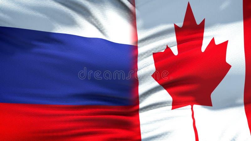 Förbindelse för bakgrund för Ryssland och Kanada flaggor diplomatiska och ekonomiska, affär arkivfoton