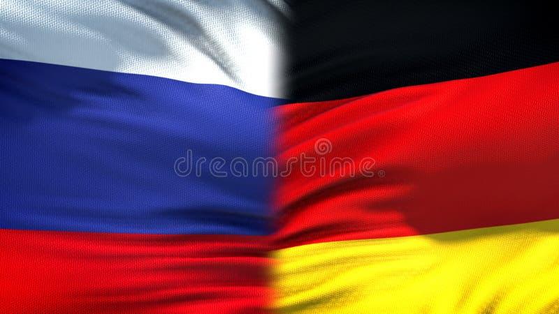 Förbindelse för bakgrund för Ryssland och Tysklandflaggor diplomatiska och ekonomiska, handel fotografering för bildbyråer