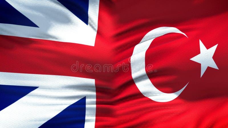 Förbindelse för bakgrund för Storbritannien och Turkiet flaggor diplomatiska och ekonomiska, arkivfoto