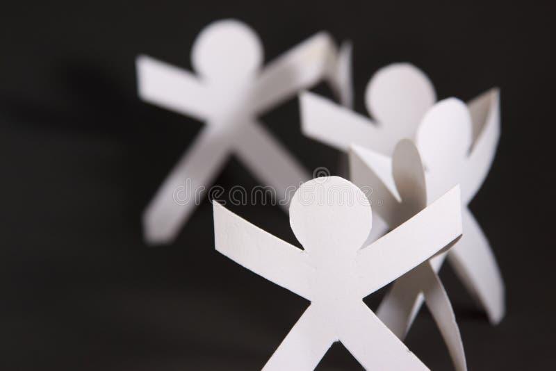 förbindelsesnitthänder rymmer paper folk deras arkivbild