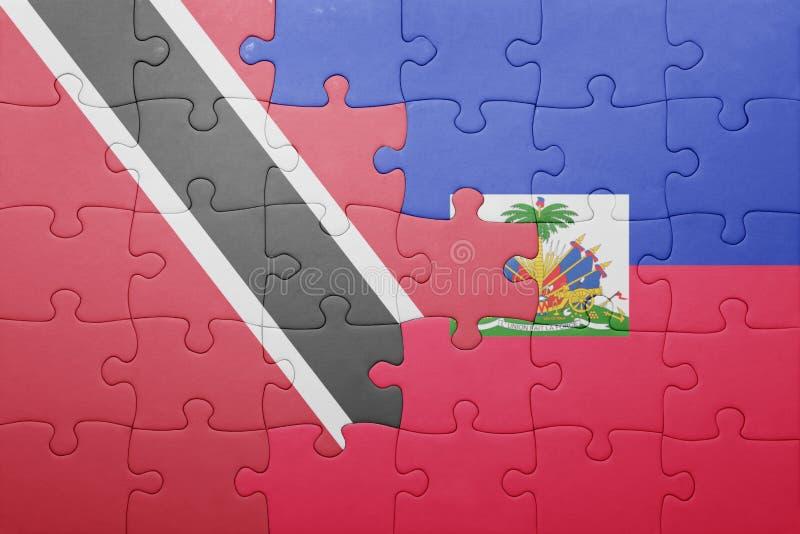 Förbrylla med nationsflaggan av Haiti och Trinidad och Tobago royaltyfri foto