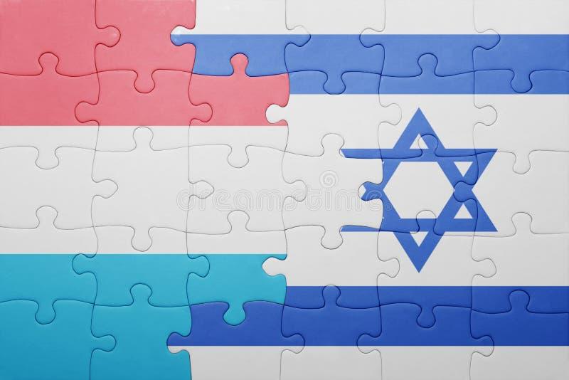Förbrylla med nationsflaggan av Israel och Luxemburg arkivfoto