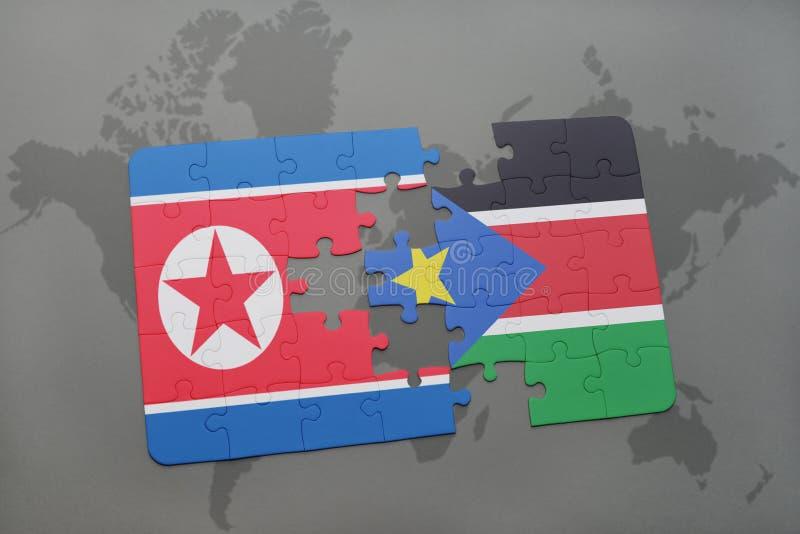 förbrylla med nationsflaggan av Nordkorean och södra Sudan på en världskarta royaltyfri illustrationer