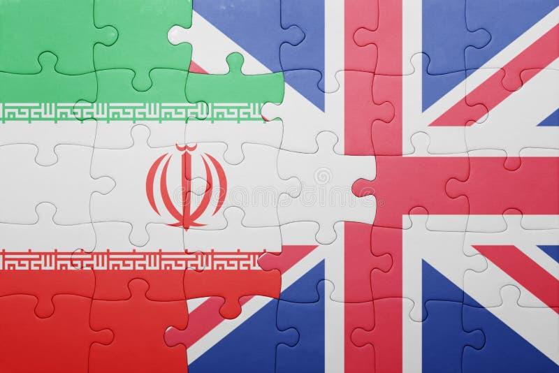 Förbrylla med nationsflaggan av Storbritannien och Iran royaltyfri bild