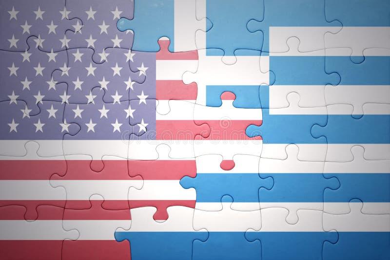Förbrylla med nationsflaggorna av USA och Grekland arkivbild