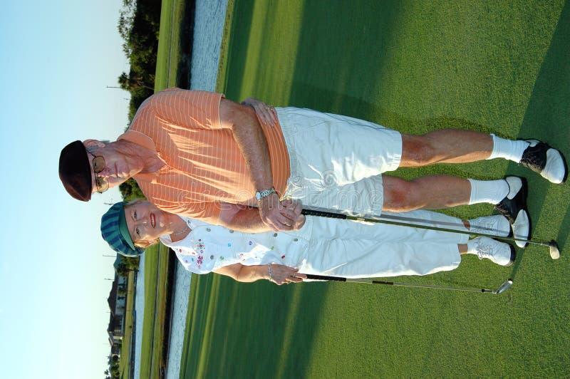 förbunden golfpensionären arkivbilder