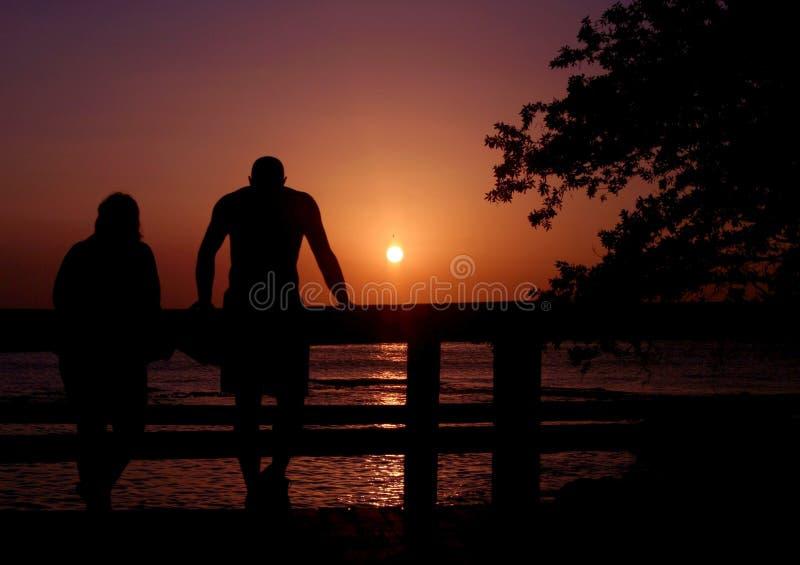 Download Förbunden solnedgången fotografering för bildbyråer. Bild av romantiker - 500751
