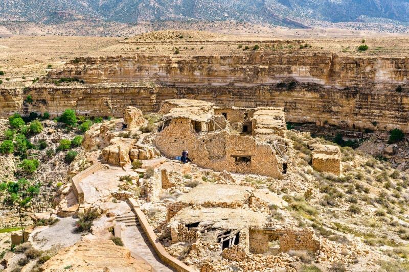 Fördärvar av ett Berberhus på den Ghoufi kanjonen i Algeriet arkivfoto