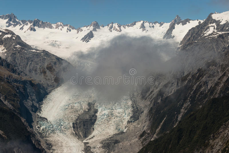 Fördunklar obsuring Franz Josef Glacier fotografering för bildbyråer