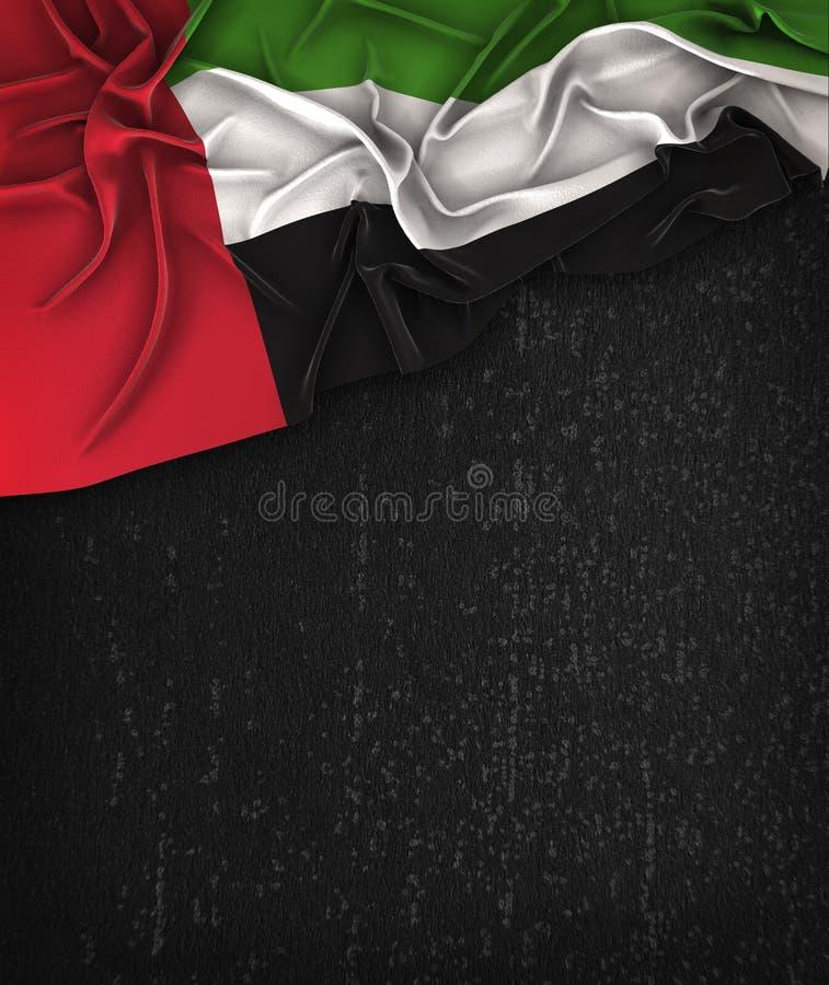 Förenade Arabemiraten flaggatappning på en svart tavla för Grungesvart royaltyfri bild