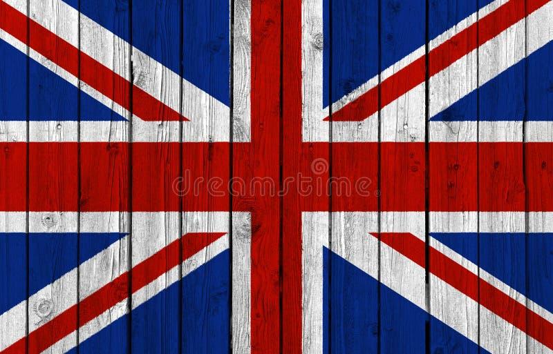 Förenade kungariket nationsflagga på gammal wood bakgrund royaltyfria foton