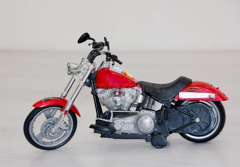 Föreställer den plast- modellen för den gamla motorcykeln det plast- släkta idén för modellleksaken begreppet leksaker för pojkar arkivbilder