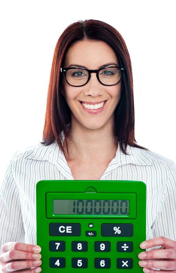 företags grön lady för räknemaskin som visar att le royaltyfria foton