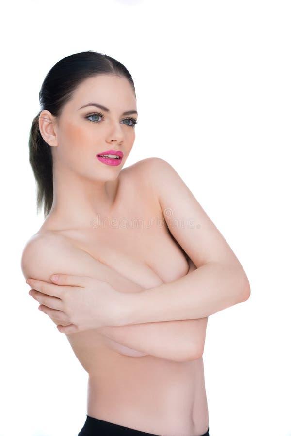 Förföriskt härligt posera för kvinna som är topless arkivbilder