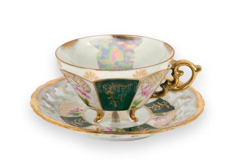 förgylld teacup för infall fotografering för bildbyråer
