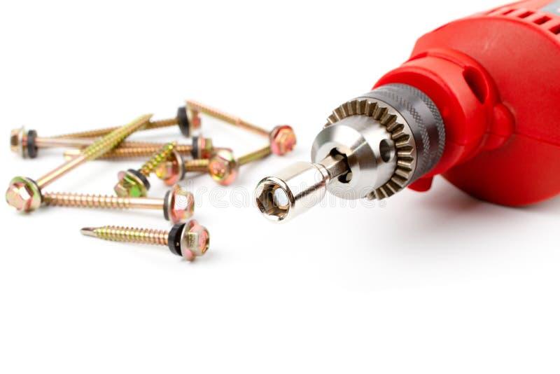 FÖRHÄXA för drillborrbiten för drev den magnetiska chauffören för håligheten och den elektriska drillborren royaltyfria bilder