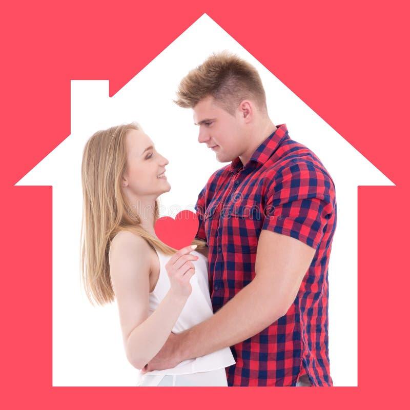 Förhållande, nytt hem- och förälskelsebegrepp - ung man och kvinna in arkivbilder