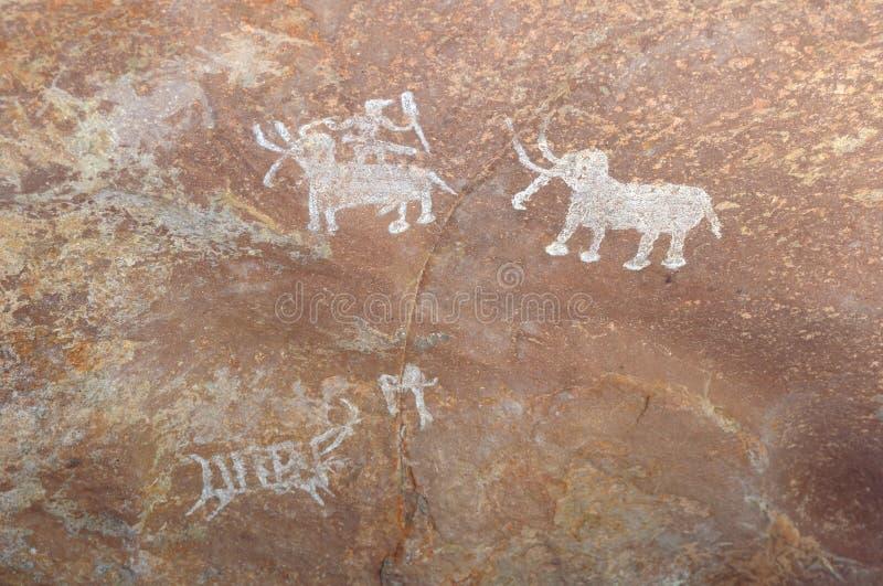 Förhistorisk grottamålning i Bhimbetka - Indien. fotografering för bildbyråer