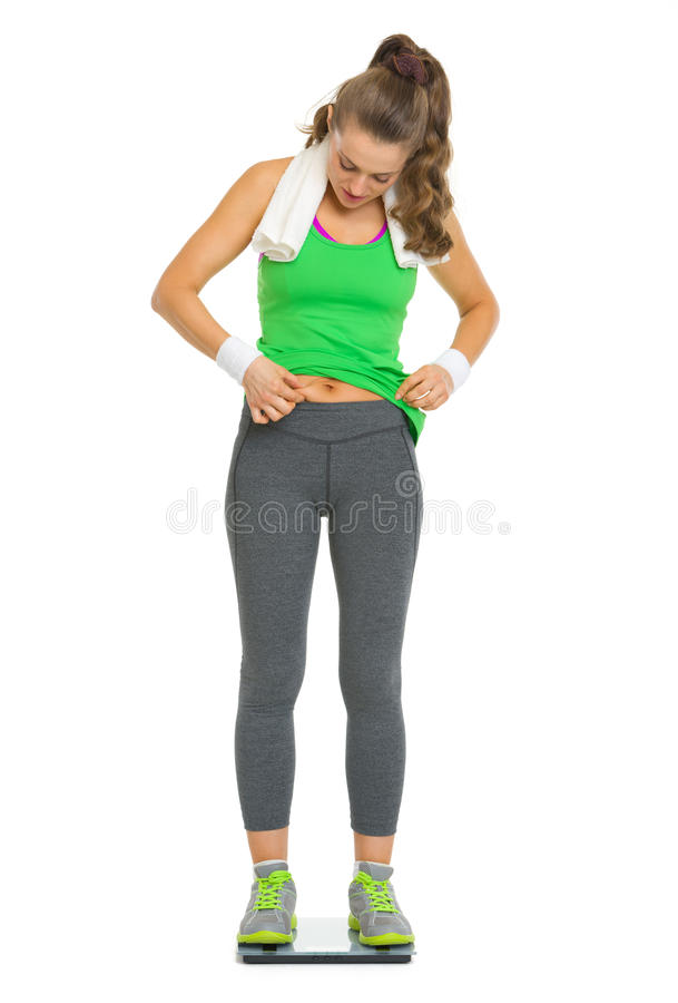 Att kontrollera för kvinna förkroppsligar fett stundanseende på fjäll royaltyfria foton