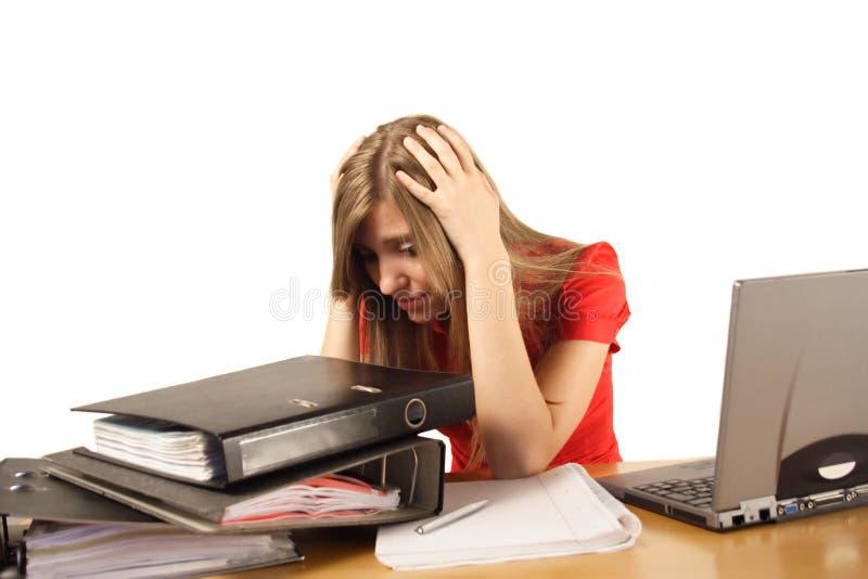 förkrossat kvinnaarbete arkivbild