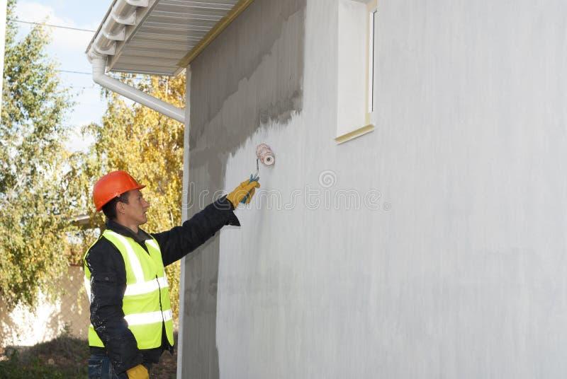 Förlagen målar väggen royaltyfria foton