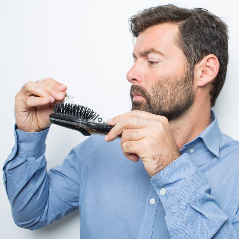Förlorande hår för man arkivfoto