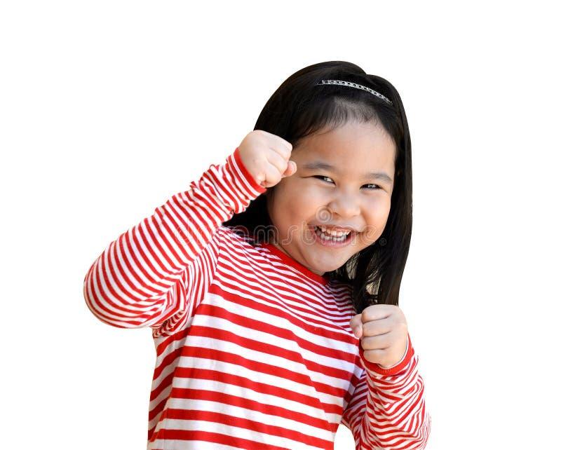 Förmodad slagställning för liten flicka, praktiserande kampsporter, självförsvar, kungfu, karate som boxas royaltyfri foto